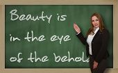 Teacher Showing Beauty Is In The Eye Of The Beholder On Blackboard