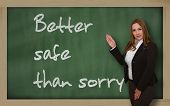 Teacher Showing Better Safe Than Sorry On Blackboard