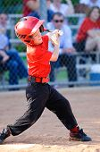 pic of little-league  - Little league baseball player full swing at bat - JPG