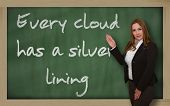 Teacher Showing Every Cloud Has A Silver Lining On Blackboard