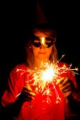 picture of guy fawks  - A beautiful woman with a sparkler celebrating the new year - JPG