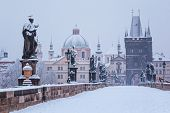 stock photo of bohemia  - snow morning at Charles bridge in winter - JPG
