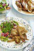 Fried pork ears with fresh salad