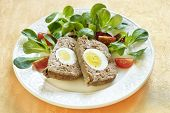 Easter baked meatloaf with boiled eggs