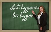 Teacher Showing Let Bygones Be Bygones On Blackboard