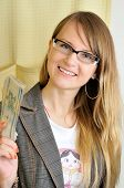 Young Pretty Successful Smiling Woman With Money In Hand