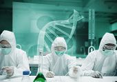 Scientists working in protective suite with futuristic interface showing DNA