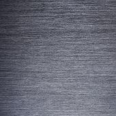 Dark brushed metal background. High resolution.