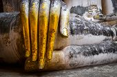 Detail Of Beautiful Golden Hand Of Sitting Buddha In Wat Si Chum Temple In Sukhothai