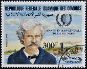 FEDERAL ISLAMIC REPUBLIC COMOROS - CIRCA 1985: A stamp printed in Comoros shows Mark Twain