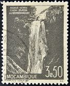 MOZAMBIQUE - CIRCA 1948: A stamp printed in Mozambique shows Waterfall at Nhanhangare circa 1948