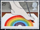 stamp printed in Great Britain shows Disabled Artist painting with Foot