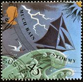 a stamp printed in Great Britain shows image of a barometer forecasting rain/stormy weather