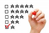 pic of dislike  - Hand putting check mark with red marker on poor one star rating - JPG