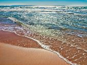 stock photo of tarifa  - gentle waves on the beach of tarifa, andalusia, spain