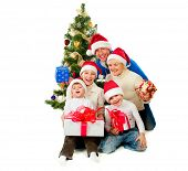 Christmas Family With Gifts near a Christmas Tree isolated on white. Laughing Big Family wearing San