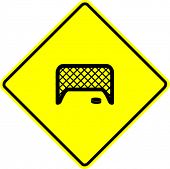 hockey puck and goal net sign