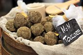 Small Swiss hard cheese balls made from cow's milk on International Cheese Festival in Bra, Northern, Italy.