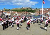 Whitby, North Yorkshire, UK August 18, 2013. Morris Dancers perform their dance at Whitby folk festival.