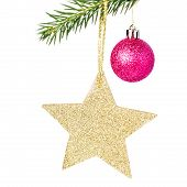 Christmas Shiny Golden Star  On Fir Branches With Decorations  Isolated On White.