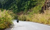 People Riding Motorcycle At On Mountain Pass