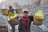 Worker Carrying Sulfur Inside Kawah Ijen Crater. Indonesia