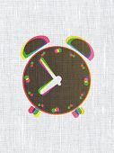 Timeline concept: Alarm Clock on fabric texture background