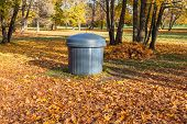Garbage Can In Autumn Park