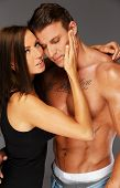 picture of hot pants  - Young woman embracing man with naked muscular torso - JPG