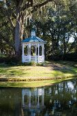 White Gazebo By Lake Under Spanish Moss
