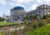 picture of beehives  - New Zealand Parliament government building known as Beehive in Wellington with Parliament House in foreground - JPG