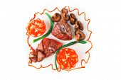 served grilled beef fillet mignon entrecote on a white plate with mushrooms and tomatoes on plate is