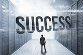 The word success and asian businessman against server hallway in the blue sky