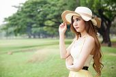 Woman Wearing A Hat At The Park.
