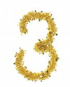 Christmas yellow tinsel with stars as number 3.