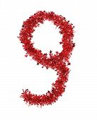 Red christmas tinsel with stars as number 9.
