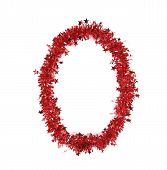 Red christmas tinsel with stars as number 0.