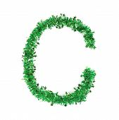 Green tinsel with stars in form of letter C.