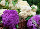 stock photo of lilas  - White and Purple Cauliflower in a straw basket at the Farmers market - JPG