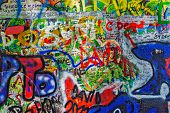 PRAGUE, CZECH REPUBLIC - APRIL 28, 2012: Lennon Wall  is filled with John Lennon-inspired graffiti a