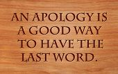 An apology is a good way to have the last word - quote by unknown author on wooden red oak background
