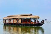 KERALA, INDIA - FEBRUARY 23, 2013: Houseboat on Kerala backwaters. Kerala backwaters are both major