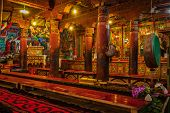 HEMIS, INDIA - SEPTEMBER 9, 2013: Interior of Hemis gompa  (Tibetan Buddhist monastery). Ladakh, Ind