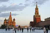 MOSCOW, RUSSIA - JUNE 27, 2008: People walk on the Red Square in evening. The Moscow Kremlin and St. Basil's Cathedral are listed as UNESCO World Heritage