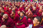KHATMANDU, NEPAL - DEC 15, 2013: Unidentified tibetan Buddhist monks near stupa Boudhanath during fe
