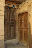 Wooden Rural Doors Of Two Neighbors