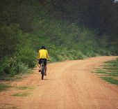 Young Man Riding Mountain Bike In Dusty Road Use For Sport Leisure And Healthy Activities