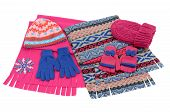 Pink and blue winter accessories isolated on white background