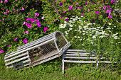 Two lobster traps used as ornaments in a flower bed.