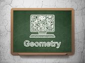 Education concept: Computer Pc and Geometry on chalkboard background